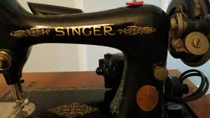 singer 1930s vine antique sewing machine in cabinet