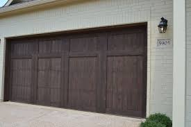 dark brown garage doorsVillage Homes Wood cedar garage door stained in a dark brown A