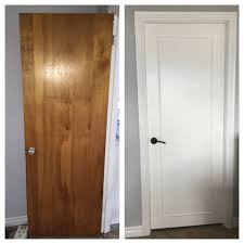 updated old wood doors to a modern look with wood trim primer white pearl paint and new handles