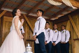 outdoor ceremony bride allure champagne lace tulle bridal gown groom white shirt brown leather suspenders navy