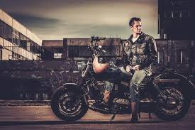 biker and his bobber style motorcycle stock photo image 52733770