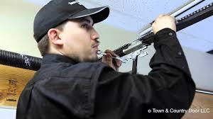 how to adjust the chain tension of garage door opener town country door llc you