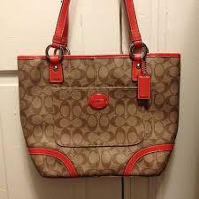 Brown and orange signature Coach purse