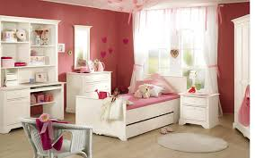 ... Enchanting Cute Kids Room Design With White Wooden Study Desk Above  Wood Floor And Single Beds ...