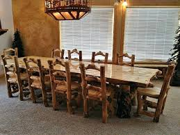 rustic dining room long rectangle table 8 chairs for sets under antique chandelier above large carpet