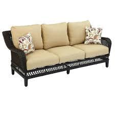woodbury wicker outdoor patio sofa with textured sand cushion