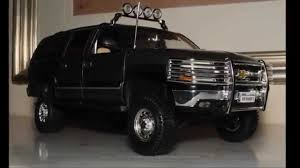 1/18 Chevrolet Suburban dark silver with accessories by Ertl - YouTube