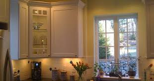 lighting above kitchen sink. kitchen with small track lighting bar above sink