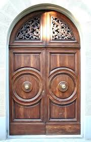 large arched wooden front door design with intricate carving detail wood photos images free cool glass and panel options wood door