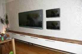 In case you're the type that likes to have 3-4 TVs wall-mounted along your  living room wall, we have the perfect IKEA hack for you.