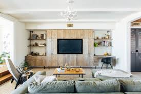 living room with industrial reclaimed wood cabinets