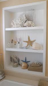seashell display in bathroom beach house