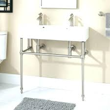 double console sink with brass metal legs pedestal