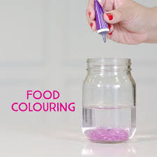 add around 3 drops of food colour and stir you can add more or less depending on your preferred shade but remember not to add too much or the mixture will