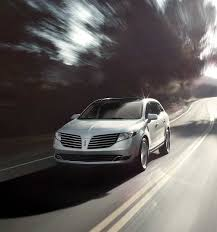 2018 lincoln mkt. modren mkt the 2018 lincoln mkt in white platinum is shown being driven along a  winding country road to lincoln mkt i