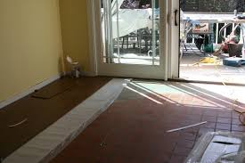 laying tile over laminate floor