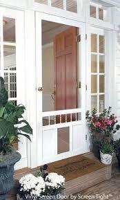 exterior door with window and dog door. an exterior screen door brings the outside in with window and dog