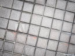 vintage style design of gray mosaic tile texture floor pattern decorate and background