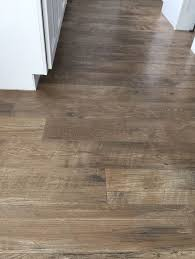 why i chose laminate flooring and how i will never regret this decision high end laminate with texture and i think it holds up to moisture pretty well