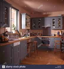 Country Kitchen Blue Grey Fitted Units And Cupboards In Terracotta Country Kitchen