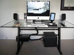 Modern Computer Desk With Glass Top And Black Legs On Grey Carpet Flooring  For Stylish Home