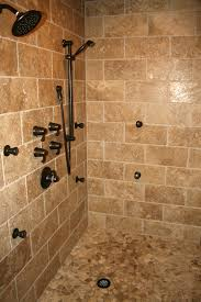 travertine tile shower with cobblestone floor