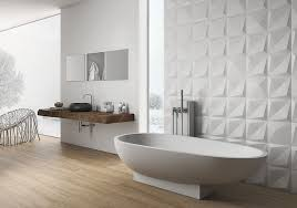 large 3 dimensional tiles on the wall just behind the bathtub add just the right amount of texture to the bathroom and give it a luxurious feel
