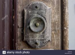 closeup image of an old doorbell