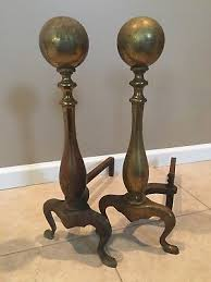 pair of vintage antique solid brass fireplace andirons