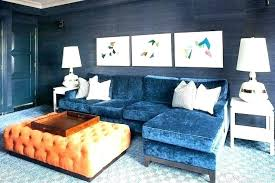 blue cowhide rug living room crushed velvet sofa orange tufted ottoman peacock door navy fiery rugs