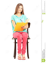 student sitting in chair.  Sitting Smiling Female Student Sitting On A Chair And Writing Notes In Student Sitting Chair N