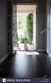Image Bcierron View Through Entrance Hall Of Baby Boy Sitting Outside At Open Front Door Looking At Fine Art America Looking Out Of Open Front Door Stock Photos Looking Out Of Open