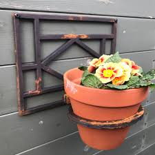 single cast iron wall mounted flower pot holder with backplate