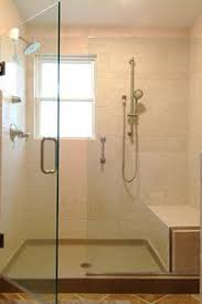 Love this shower concept with two heads, and the walk in with seat making it