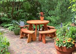 round wooden picnic table with detached