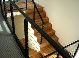 View in gallery A modern metal handrail in ...