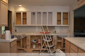 prepping unfinished oak cabinets for paint 9