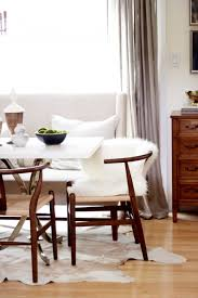 delightful dining table rugs decor furniture artistic white wool chair in parquet flooring dining room