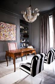 the office walls and high ceiling are bathed in a charcoal gray which accentuates the high ceilings with a focal point chandelier