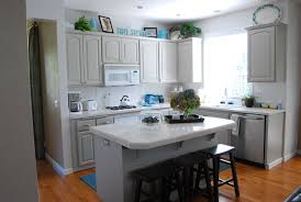 cool interior with grey kitchen cabinets also white countertop plus black bar chairs