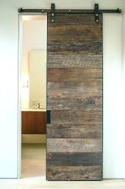 reclaimed sliding barn doors traditional bathroom decor with rustic accent sliding barn door rails reclaimed wood reclaimed sliding barn doors