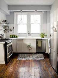 dlightful small kitchen design idea with white kitchen cabinet gray wall and brown hardwood floor tile