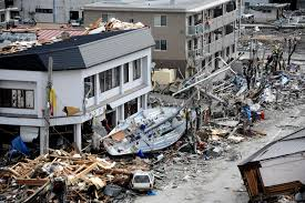 u s department of defense photo essay a fishing boat crashes against a building after being swept ashore during a massive tsunami that