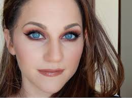 warm red grunge makeup look for blue and green eyes