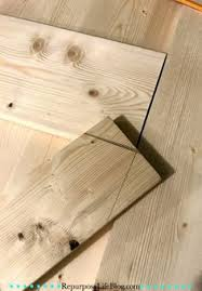 a simple step by step how to make a sliding barn door