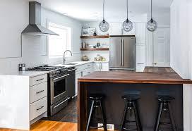 home kitchen designs. kitchen:inovative pendant lamp decor with brown kitchen countertops also modern refrigerator and ove white home designs i