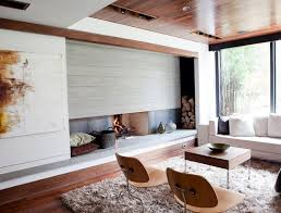 mixing materials is another way to totally revamp your fireplace area image capoferro design build group