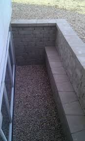 brick basement window wells. Delighful Basement Charming Egress Window Wells With White Frame And Brick Retaining Wall For  Home Exterior Design Ideas For Brick Basement Window Wells T