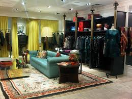 colorful store interior, teal couch, yellow drapes, old rug. Boutique  DecorBoutique InteriorBoutique DesignBoutique IdeasRetail ...