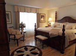 chair in front of bed. mesmerizing valances for bedroom windows completing beautiful interior setting : fascinating round shaped rug in front chair of bed i